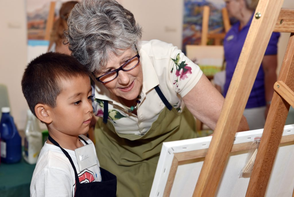 Zac Demmead gets some handy tips from exhibiting artist Beverley Tainton at the Little Skippers Club.