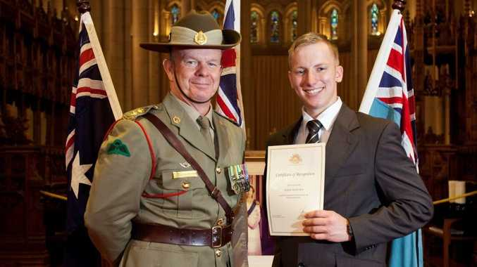 Former Cabarlah man Jackson Best (right) receives his appointment as an Australian Defence Force Academy general services officer from a Defence Force staff member.