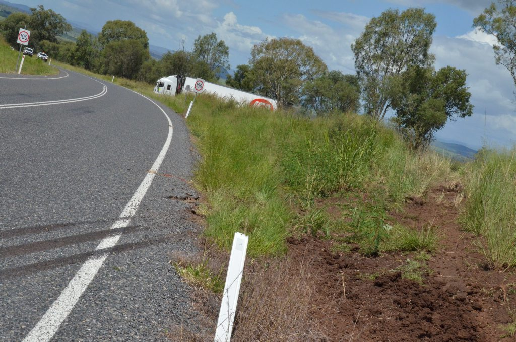 CRASH: A truck driver, who reported being surprised by a brown snake in his cabin, veered across the road on the Binjour Range, through tall grass and twice over a barbed wire fence before coming to halt - with no injuries. Photo Shirley Way / Central & North Burnett Times