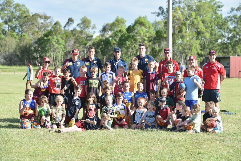 Brisbane Lions players visit Maryborough's Bear Park.