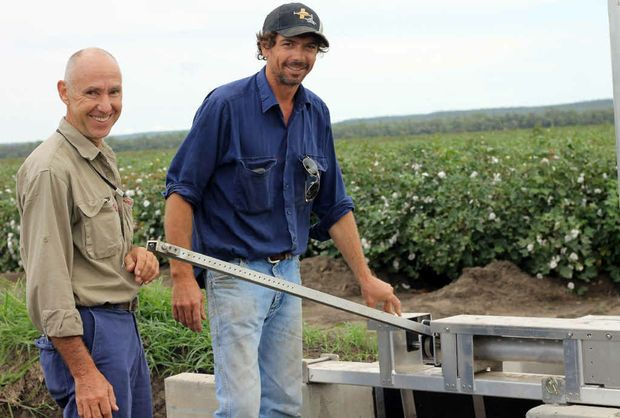 AUTOMATION: Dr Pendergast with farm owner Cameron Geddes next to the automatic gate on the head ditch.