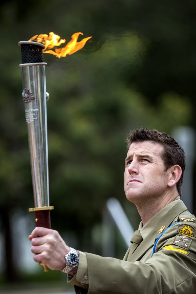 Victoria Cross recipient Corporal Benjamin Roberts-Smith with the Anzac torch, similar to the one that will be sent to Hervey Bay.