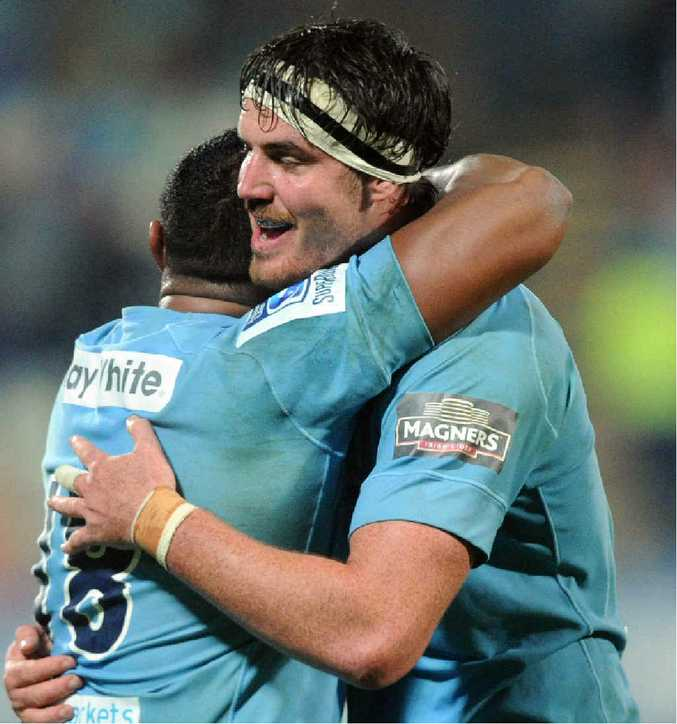 COME BACK: Kane Douglas embraces Sekope Kepu as they celebrate a win during the 2014 Super Rugby season. PHOTO: AAP/NZN IMAGE/SNPA, ROSS SETFORD