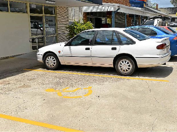 CAMPAIGN: Murray James (inset) wants more than one disabled parking at Tin Can Bay's Dolphin Shopping Centre (above).