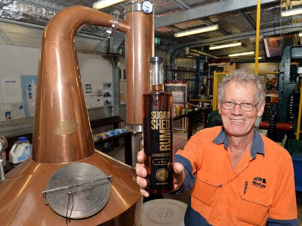 Operator Phil Taylor at the Sarina Sugar Shed with the new copper pot still which will be used to make a premium rum.