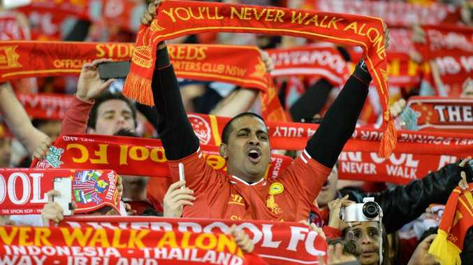 Liverpool supporters sing as they watch the match between Liverpool and the Melbourne Victory in a football friendly match at the MCG in Melbourne on July 24, 2013