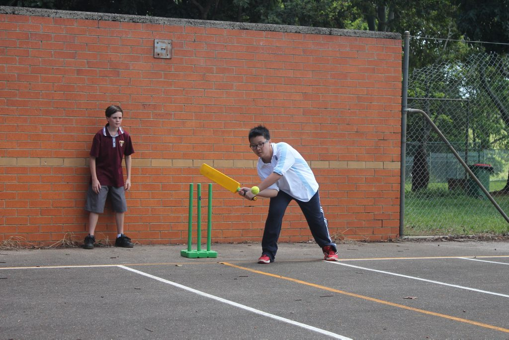 SWING AND A MISS: Chinese student Shak hit this one, though, in the first time he had played cricket. Photo Graham Broadhead / Ballina Shire Advocate