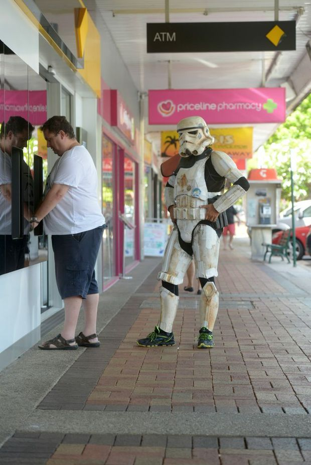 Image for sale: IMPERIAL FORCES: Stormtrooper Scott Loxley visits Bundaberg in his 15,000km trek around Australia to raise money for Monash Children's Hospital. Photo taken on 13 February 2015. Photo: Max Fleet / NewsMail