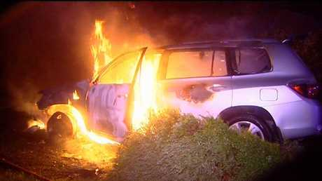 Middle Ridge resident Jack Gardner's car is engulfed in flames minutes after he was rescued from it by a neighbour. Photo Peter Collins, Channel 9 News