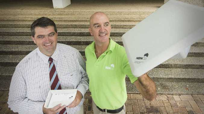 UNWIRED: Clarence Valley Council Mayor Richie Williamson with NBN Co. community relations advisor Tony Gibbs with one of the NBN fixed wireless antennas.