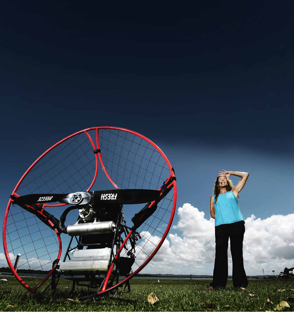 LET'S FLY AWAY: Jan Smith (main picture), of Ballina, is hoping to set a world first when she para-motors from Cape York to Papa New Guinea. she is show (at left and below) practising.