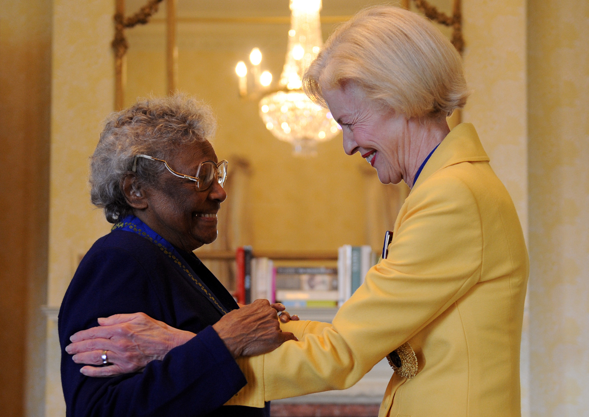 Governor-General Quentin Bryce (right) embraces Aboriginal rights campaigner Faith Bandler after investing her with the Companion of the Order of Australia at Admiralty House in Sydney, Wedesday, April 29, 2009. Mrs Bandler was awarded the AC in the 2009 Australia Day Honours for distinguished service to the community through the advancement of human rights and social justice.