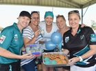 Cricket mums Amanda Polsen, Julie Wynn, Karlie Holloway, Paula Reck and Rebecca Miles with goodies for sale at the Afternoon Teal fundraiser for Ovarian Cancer Australia.