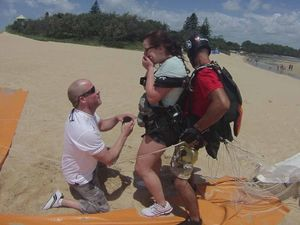 Love in the air as beau pops question after tandem skydive