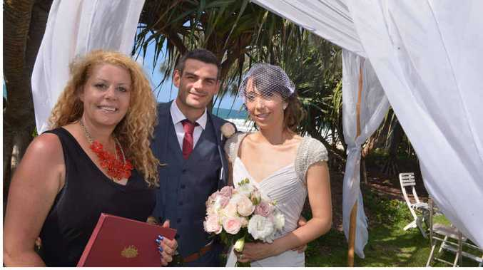 SIMPLE CEREMONY: Celebrant Lynette Maguire with newlyweds Tristan Lowe and Selene Trevino Medina opted for a pop-up wedding ceremony on Noosa Main Beach.