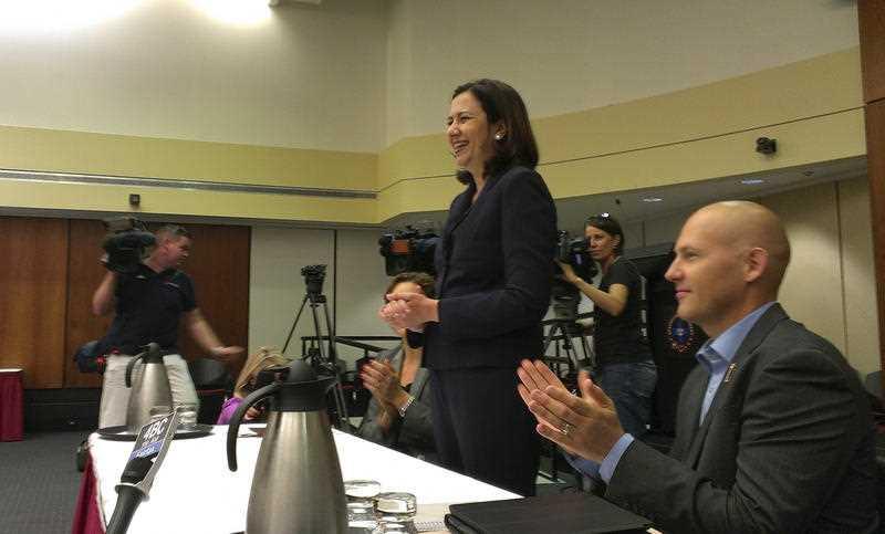 New Queensland premier Annastasia Palaszczuk addresses her caucus with deputy premier Jackie Trad and treasurer Curtis Pitt, Sunday,Feb. 15, 2015.