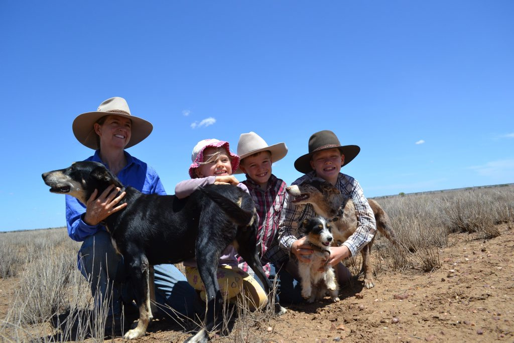 Rachael Webster with Joe, Dominic and Lucy Faggotter with dogs Jess, Boo and Molly at Mt Victoria, outside Longreach. Photo: Jenna Cairney