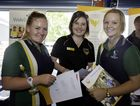 Xavier Catholic College students Sarah Crumblin (left) and Elise Anderson chat with USQ school engagement officer Emma Molen at last year's Uni Showcase Fraser Coast event.