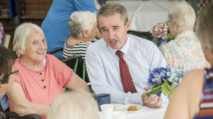 CUPPA AND A CHAT: Member for Page Kevin Hogan speaks with residents and carers at the Whiddon Group Aged Care Facility in Grafton, which is being expanded. Photo: Adam Hourigan