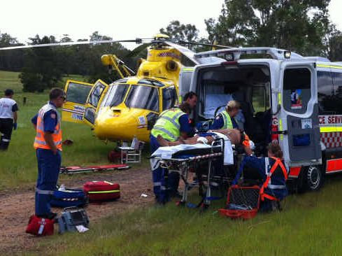 NSW Ambulance and Westpac helicopter crews at the accident on the Summerland Way involving a single vehicle rollover near Whiporie. PHOTO: CONTRIBUTED