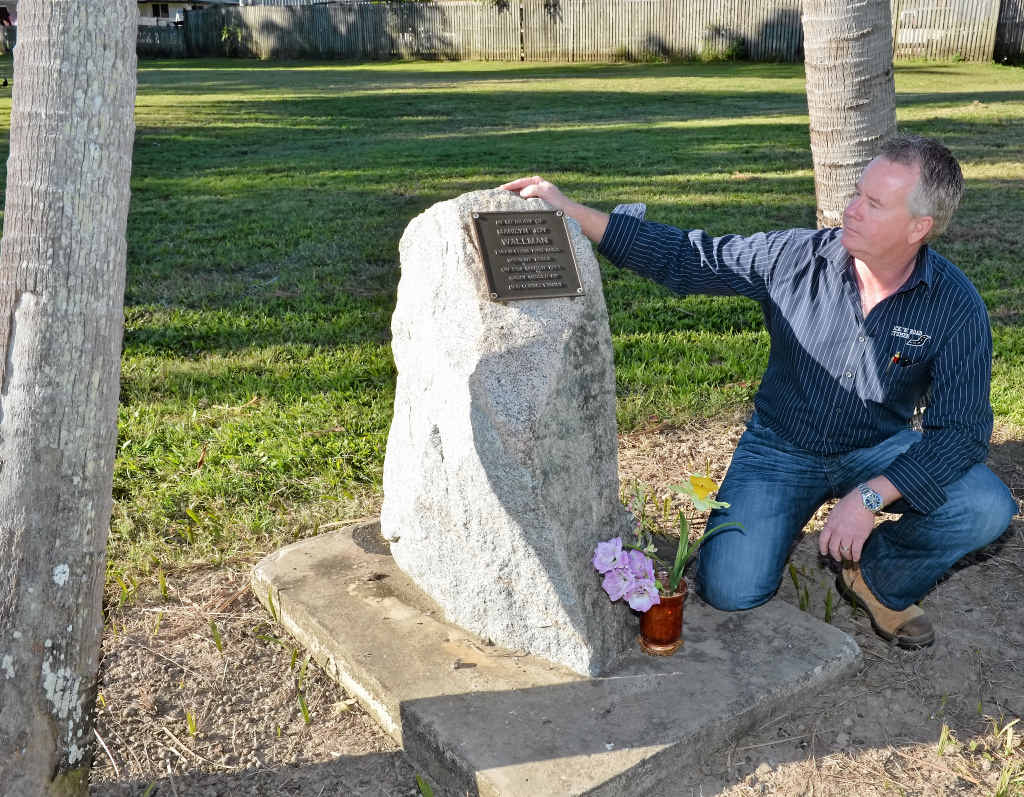 Rex Wallman beside the monument to his sister, Marilyn Wallman, at Mackay's Northern Beaches.
