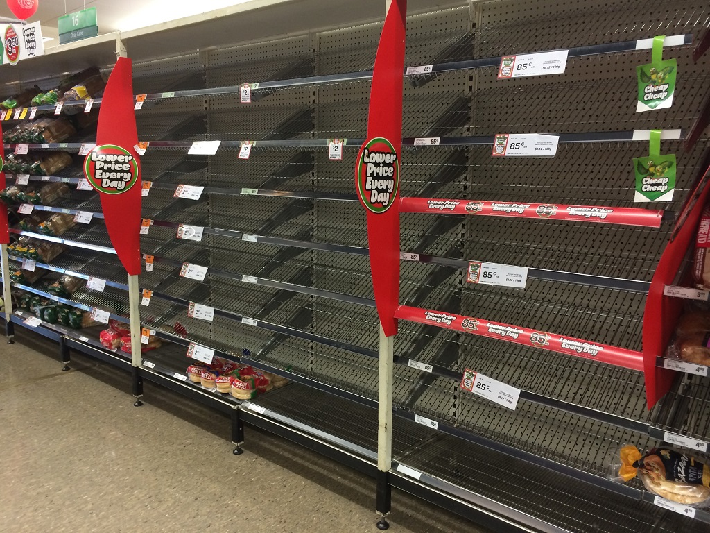 Many shelves, normally filled with bread, are bare at Woolworths in Pialba on Wednesday afternoon.