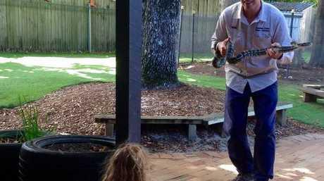 Snake Catcher Richie Gilbert talks to kindergarten kids about the dangers of snakes.