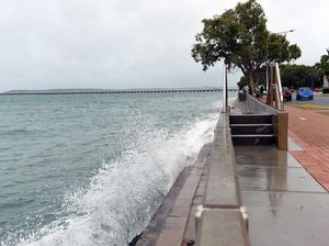 Waves crash over the Urangan seawall