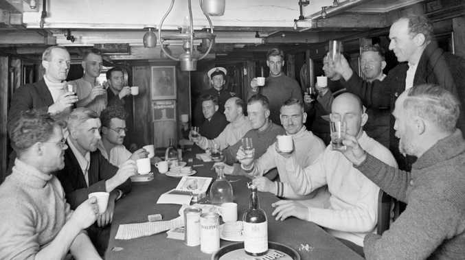 To our next meeting. On board the Discovery, c.1931. Photographer: Frank Hurley. NAA: A461, D413/2 National Archives collection