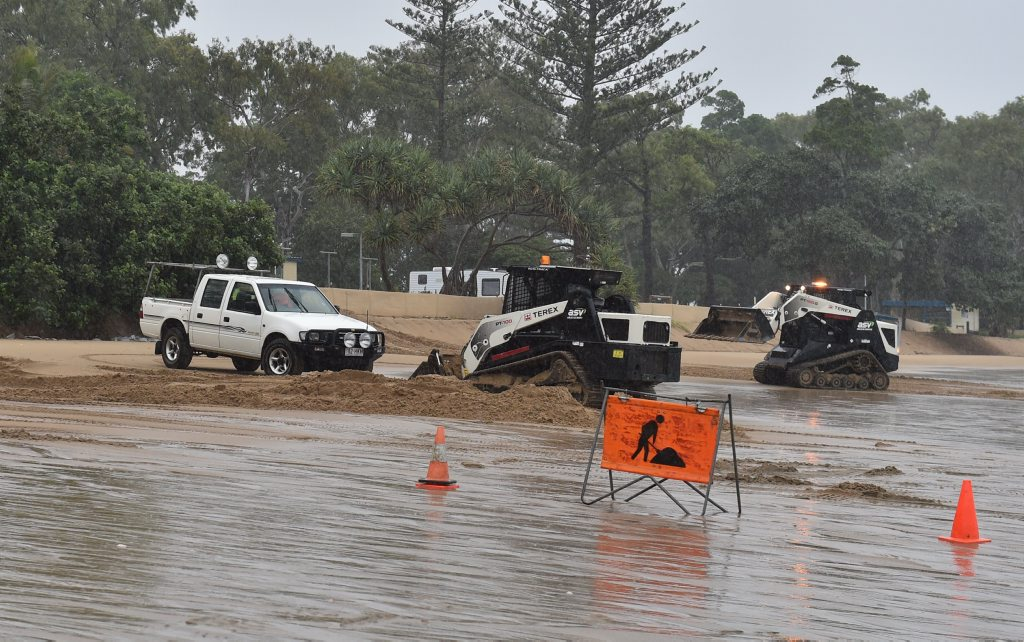 More sand is pushed up the beach at Torquay after Thursday morning's high tide.