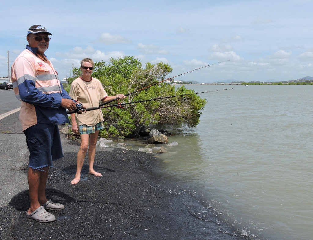 Ray and Pam Mills, of North Mackay, wet their lines near the River St boat ramp just after the tide peaked at 6.41m yesterday.