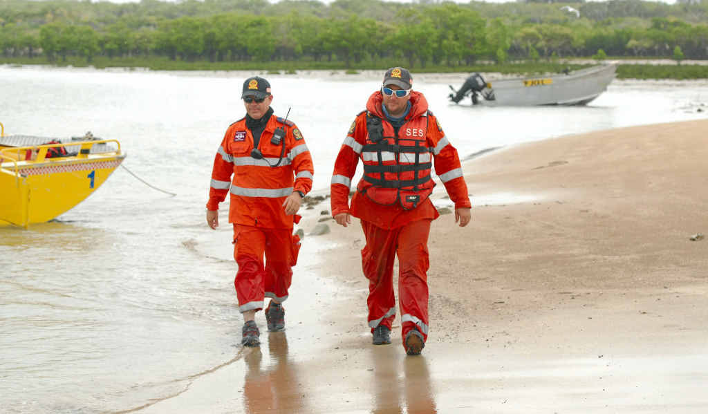 Mackay SES controller Justin Englert and volunteer Ben Taylor assist in the search for a missing man at Notch Point last year.