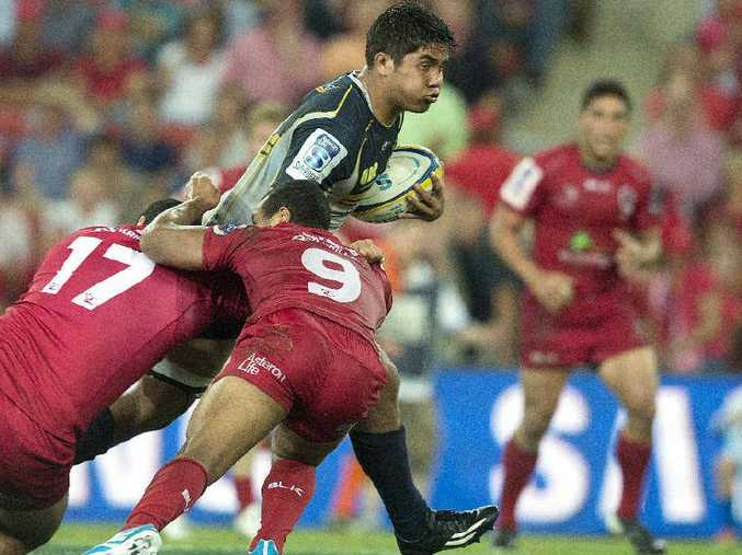 STEPPING UP: The Brumbies' Jarrad Butler takes the ball forward last season against the Queensland Reds.
