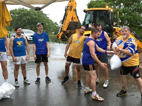 Ipswich Eagles Aussie rules players helping with sandbags at Limestone Park on February 19, 2015. Photo: Contributed