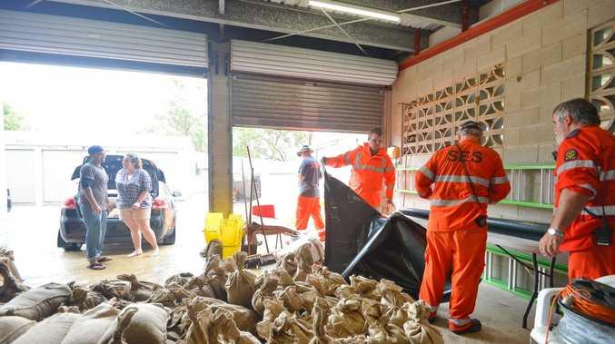Gladstone SES volunteers prepare sandbags as Cyclone Marcia approaches.