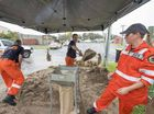 BAGS OF WORK: The Yamba SES were hard at work yesterday filling sandbags by hand yesterday, ready for localised flooding.
