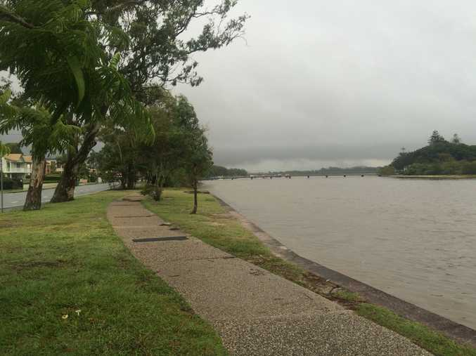Dark clouds loom over Maroochy River.