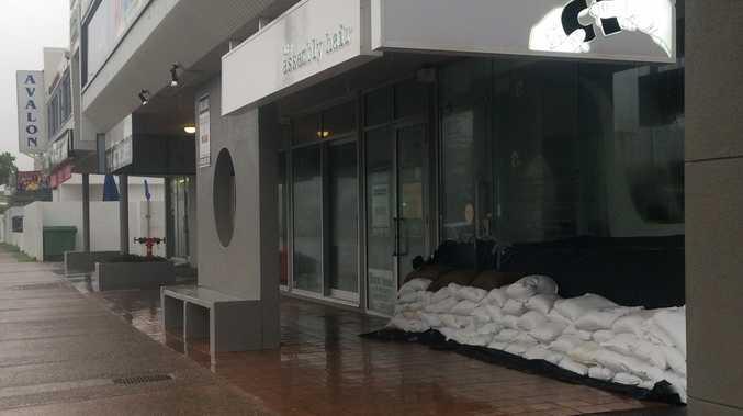 Businesses along Alexandra Parade undertake sandbagging.