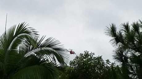 Chopper in the skies above Beerwah looking for kids missing in flood.