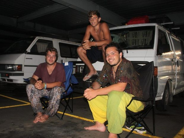 French backpackers (from left) Martin Vercampt, Sullivan Gaume and Remi Dussetier took shelter from Cyclone Marcia at the Arcade carpark on Bolsover St, Rockhampton Photo Guy Williams / Morning Bulletin