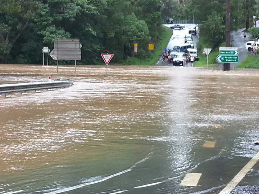 The intersection of Old Gympie Rd and Peachester Rd, Beerwah. is one metre underwater and residents along Old Gympie Road have been cut off from town and also from Glasshouse Mountains, effectively isolating them as of Friday night. Photo: Chris Rawlins
