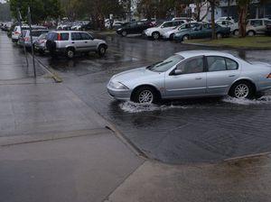 Rivers falling but flood warnings remain as rain eases