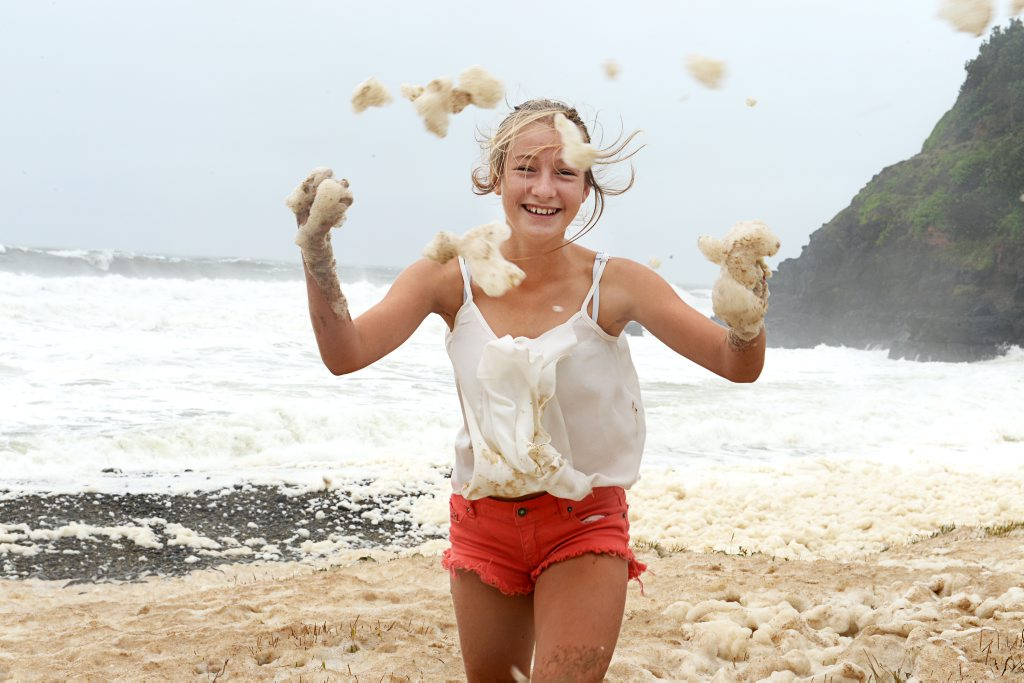 Grace Killingbeck, 12 of Lennox Head, checking out the foam coming from the ocean at Boulders Beach, during this weekend storm.
