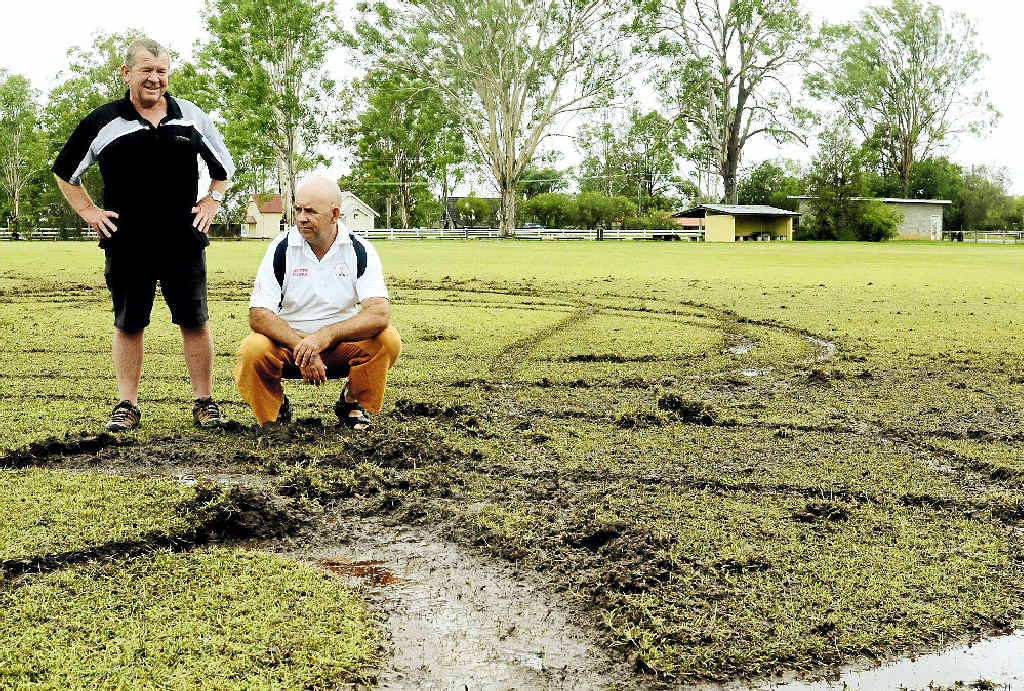 REPAIR DESPAIR: Clarence River Cricket Association grounds committee representative Terry Brien and Coutts Crossing Cricket Club vice-president Dean Clark survey the damage on the cricket field at McIntosh Park.