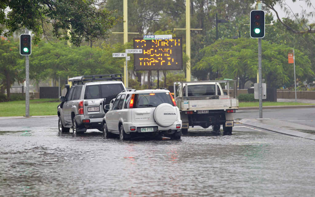 OVERFLOWING: More than 24 hours of rain on the Sunshine Coast left water over many roads, including Cotton Tree Esplanade.