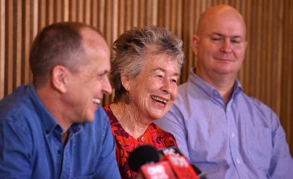 Peter Greste (left), his brother Mike and his mother Lois, at a press conference in Brisbane after his release.