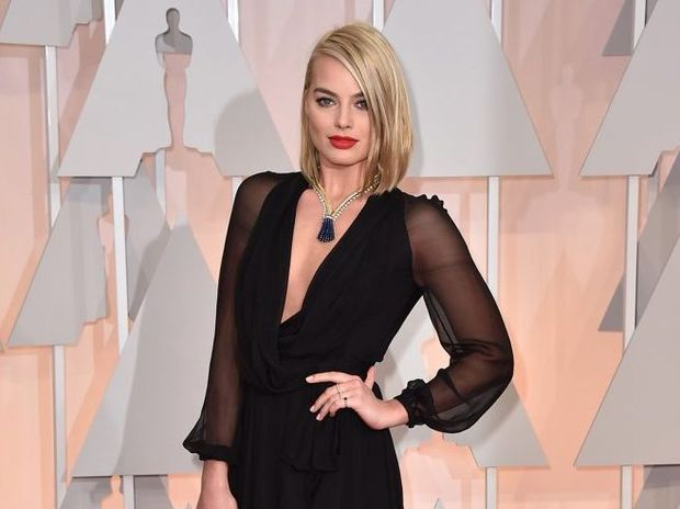 Margot Robbie arrives at the Oscars at the Dolby Theatre in Los Angeles.