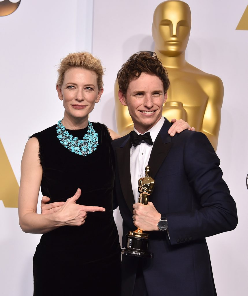 Cate Blanchett and Eddie Redmayne pose in the press room with his award for best actor in a leading role at the Oscars.