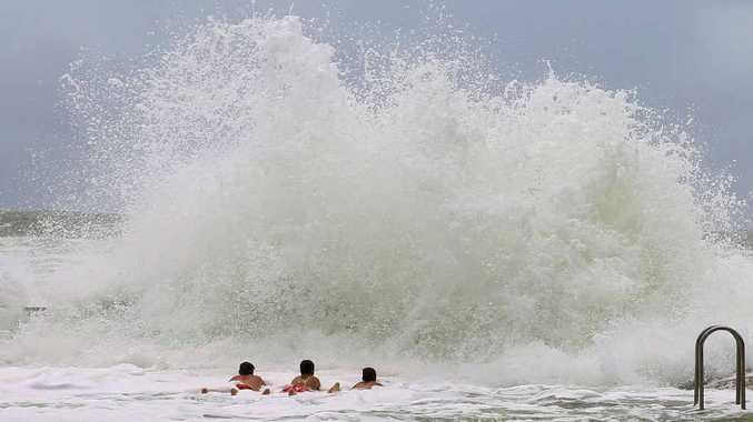 THRILLING VIEW: Steve Ward snapped these fearless children in the waves at Main Beach Yamba. PHOTO: CONTRIBUTED