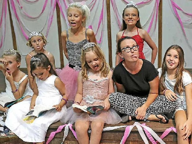 NOT A PRINCESS: Writer and journalist Samantha Turnbull, author of The Anti-Princess Club book series, is surrounded by girls from the Byron shire.
